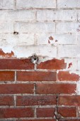 Red brick wall half painted in white vertical image — Stock Photo