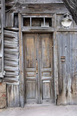 Obsolete wooden door of very old house in Astrakhan, Russia — Stock Photo