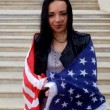 Happy latino women posing with stars and stripes flag outdoors. — Stock Video #68043311