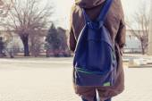 Rear view of hipster girl carring backpack on her back, copyspace — Stock Photo