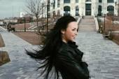 Long haired brunette happy in the wind. — Stock Photo