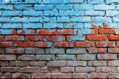 Old red brick wall half painted in bright blue color a lot of copyspace background — Stock Photo
