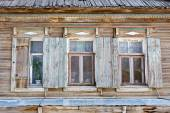 Three old russian style wooden window in Astrakhan, Russia. Urban decay. Heritage. — Stock Photo