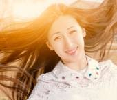 Beauty Romantic Girl Outdoors Closeup. Beautiful Asian Teenage Model Girl in Casual Dress with Jevels in Sun Light. Blowing Long Hair. Autumn. Glow Sun, Sunshine. Backlit. Toned in warm colors — Stock Photo