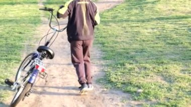 Young school boy on a bicycle — Stock Video