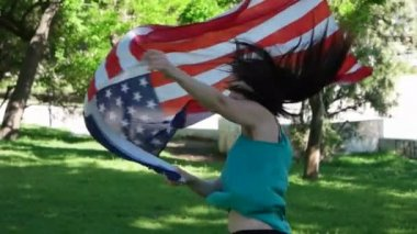 Beautiful patriotic  young woman with the American flag held in her hands dancing slowmo — Stock Video
