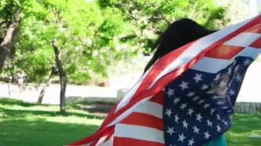 Patriotic  young woman with the American flag held in her hands dancing slowmo — Stock Video