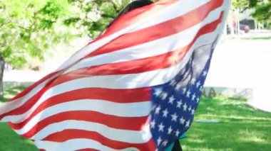 Happy patriotic  young woman with the American flag held in her hands dancing slowmo — Stock Video