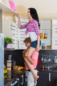 Man helps his wife in cleaning — Stock Photo