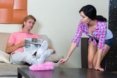 Young woman cleaning the apartment — Stockfoto