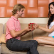 Man gives a gift to a woman — Stock Photo #53287785