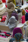 Sale knitted winter hats — Stock Photo