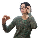 Woman  in  glasses looks at medicament — Stock Photo