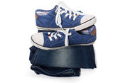 Jeans and blue sneakers — Stock Photo