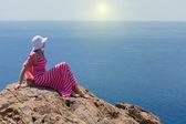 Woman in a long summer dress in Greece, Santorini. — Stock Photo