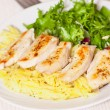 Chicken breast with pasta and salad — Stock Photo #65510457