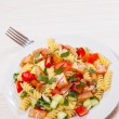 Pasta salad with smoked salmon and vegetables — Stock Photo #82226188