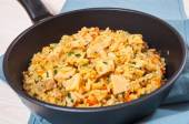 Chicken Breast with Rice and vegetables in a frying pan — Stock Photo