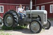 Boy on vintage tractor — Stockfoto