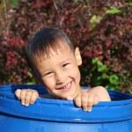 Boy in barrel in water — Stock Photo #56220273