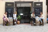 People in street cafe of Barcelona — Stock Photo