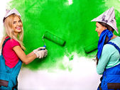 Women paint wall — Stock Photo