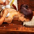 Постер, плакат: Woman having massage with pouch of rice