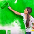 Woman paint wall at home. — Stock Photo #52884741