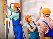 Group people in builder uniform. — Stockfoto
