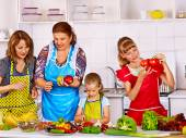 Happy family  with child and grandparent cooking at kitchen. — Stock Photo