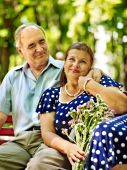 Old woman sit in hand of senior man. — Stock Photo
