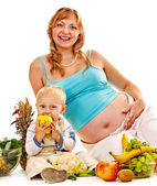 Pregnant woman with food . — Stock Photo