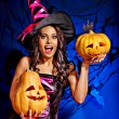 Witch holding pumpkin — Stock Photo #56058469