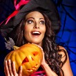 Witch holding pumpkin — Stock Photo #56058473