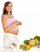 Pregnant woman eating vegetable. — Stock Photo