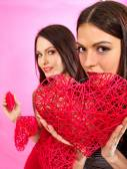 Lesbian women holding heart symbol. — Stock Photo