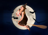 Witch flying on broomstick — Stock Photo