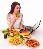 Woman eating junk food. — Stock Photo