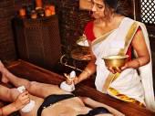 Woman having Ayurvedic  massage. — Stock Photo