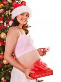 Pregnant  woman with Christmas box. — Stock Photo