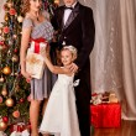 Family dressing Christmas tree. — Stock Photo #58344401