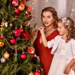 Family dressing Christmas tree. — Stock Photo #58344583