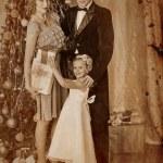 Family dressing Christmas tree. — Stock Photo #58940433
