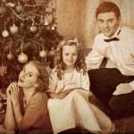 Family dressing Christmas tree. — Stock Photo #58940829
