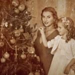 Family dressing Christmas tree. — Stock Photo #58940871