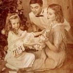 Family dressing Christmas tree. — Stock Photo #58943641