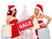 Женщины с продажей знака — Стоковое фото