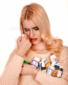 Woman having flu takes pills. — Stock Photo