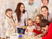 Family rolling dough in kitchen — Stock Photo