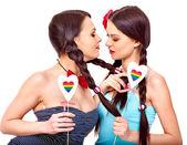 Lesbian women with hearts — Stock Photo